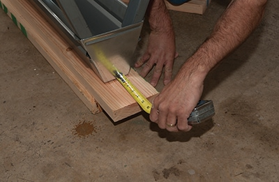 The 2x6's we add to the tops of folding saw horses are a few inches longer than the horses for added material stacking.