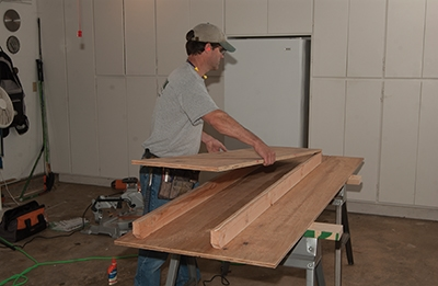 Place the main table surface on the 2x4 runners.
