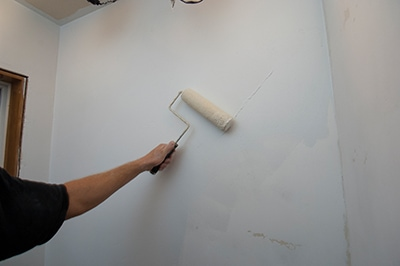 It's important to apply primer over the finished skim coat before painting with the top coat. Primers fill tiny voids in the drywall compound for proper sealing and adhesion.