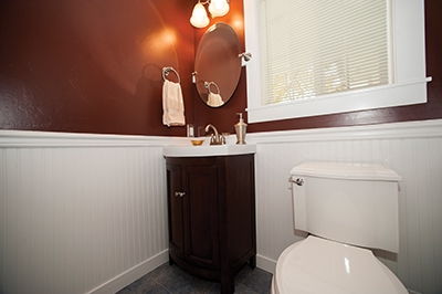 The finished bathroom includes a new wall color of the homeowner's choosing, which can be easily changed with paint for future updates.