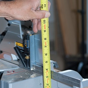 Place a wing board on the table next to the saw base and measure from the wing board to the saw surface to determine the height of the wing-board support blocks.