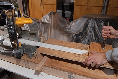 The wing boards also provide an excellent surface to clamp a stop for making multiple cuts of the same length.
