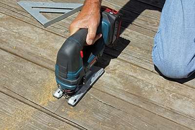 A saber saw is used to make the cut. The Bosch cordless saw is ideal for the job.