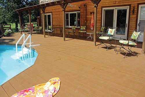 Restained and reinstalled pool railings finish off the deck/pool surround.