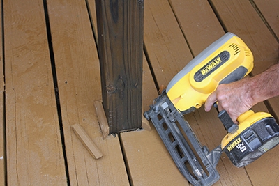Trim boards are then installed using a cordless finish nailer and stainless steel finish nails.