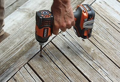 Old screws are removed using an impact driver. Go slowly or you may strip out heads and have a real problem.