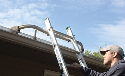 A ladder stabilizer will hold you steady.