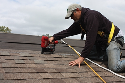 A fall-restraint safety harness should be used when working on the roof.