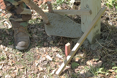 Roughly 50lbs. of concrete anchors the posts.