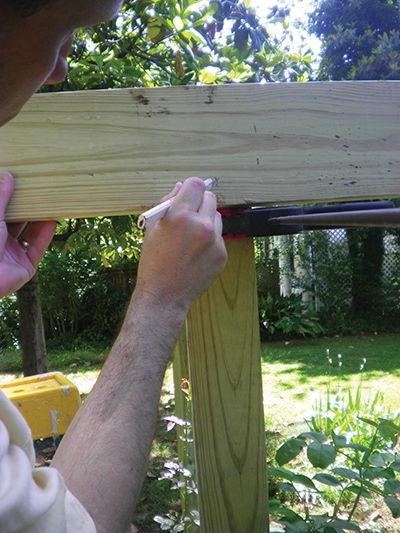 Mark corresponding bolt holes on both the posts and the 2x6 band.