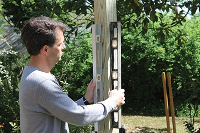When installing the posts, check each side with two hand levels (or a post level) to ensure plumb alignment.