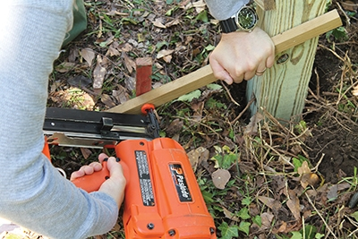 Secure the 4x4s in place with wooden braces and stakes driven into the ground.
