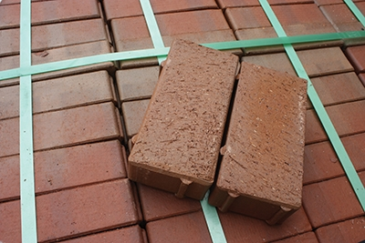 For patios, clay pavers are more durable than face bricks, able to withstand up to 13,000 lbs. per square-inch of pressure.