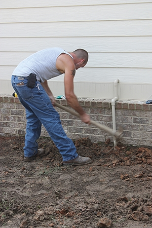 Dig deep enough for the thickness of the pavers plus a minimum of 4 inches for crushed rock and an inch of sand to use a leveling bed.