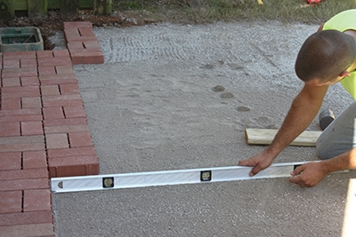 Make sure to build the patio with a consistent slope to drain water away from the home.