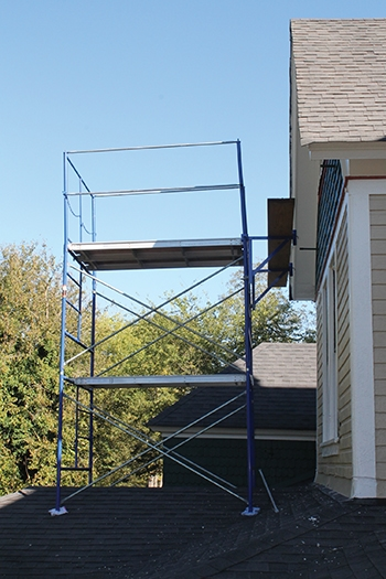Scaffolding can be set up on the ground level or on a lower roof.