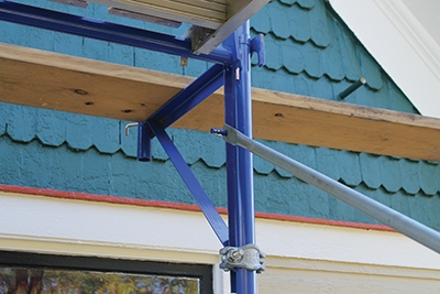 End brackets hook and bolt onto the scaffolding frame to extend the work area.