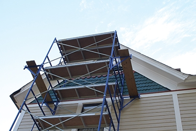 Side brackets accomplish the same work-surface extension on the sides of the scaffolding.