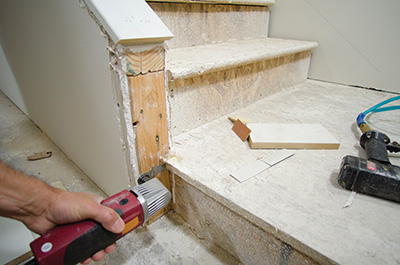 Cutting a notch in the nose of the landing made room for the vertical wall piece.