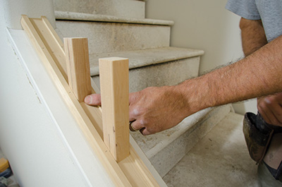 We used the end cuts from a new balusters to test the baluster layout by standing them in the shoe rail.