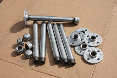 "The shelf brackets are built from ¾"" galvanized pipe, end caps and floor flanges."
