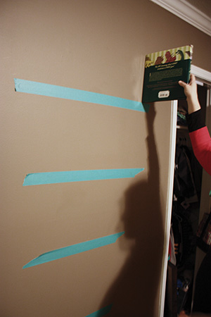 My wife and I used painter's tape to represent the shelf locations as we experimented with placement.