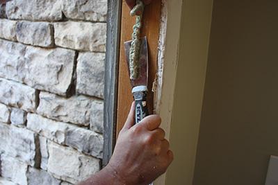 Scrape away excess insulation or caulking.