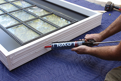 Liberally apply beads of high-quality sealant to the joint between jambs.
