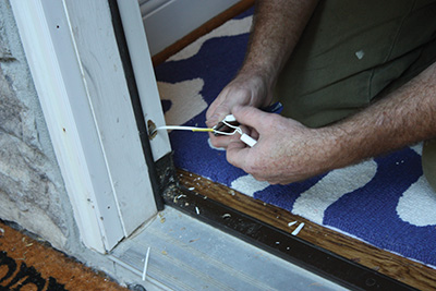 Disconnect any electrical security system wires. & Entry Door and Transom Window Replacement - Extreme How To