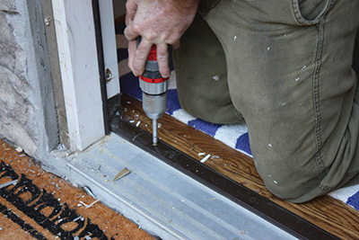 Unscrew the threshold from the subfloor.