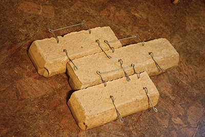 The rear of these stones show how the wire clips interlock on the rear of the veneer.