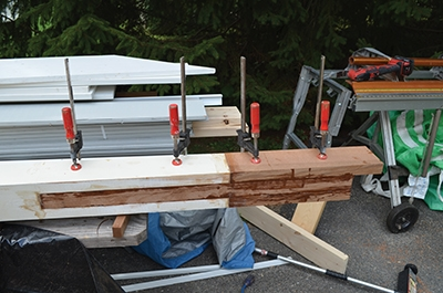 Additional cedar blocking was epoxied and clamped onto the keyed piece to extend and strengthen the post base.