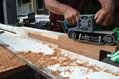 The joint is fine-tuned with a belt sander.