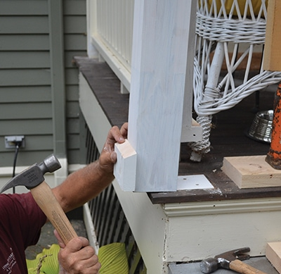 Lift the overhead structure slightly with the jack and install the repaired post.