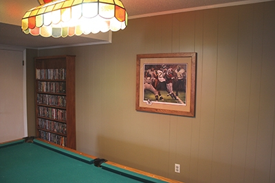 Before: The previous owner had remodeled the basement with wall paneling.