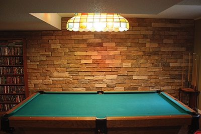 The completed veneer gives the basement a warm, rustic feel and greatly enhances the look of the room.
