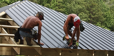 After completing the roof panels, the ridge seams at the adjoining sections of roof deck must be covered.