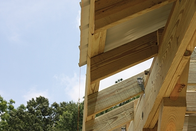 To help gauge the overhang, attach a layout string parallel to the eave as a guide.