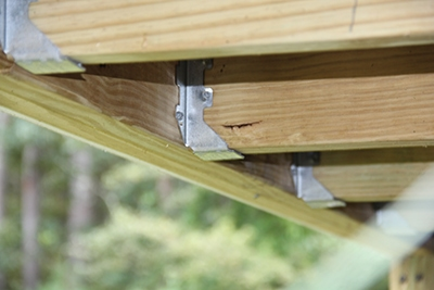 Use metal joist hangers to connect all joist ends.