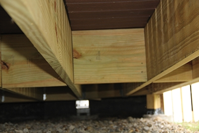 Small sections of joist material can be installed between the joists as mid-span blocking to help prevent deck bounce and strengthen through-the-deck rail post attachments.