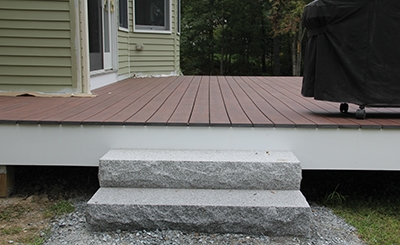 Granite steps provide access to the finished deck.