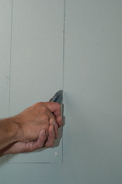 glass box use utility knife to score the drywall face