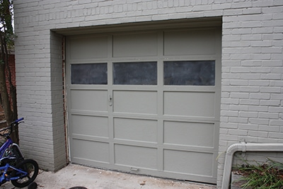The goal of this project: Replace the overhead garage door with a double door so the interior can be remodeled as a family room.