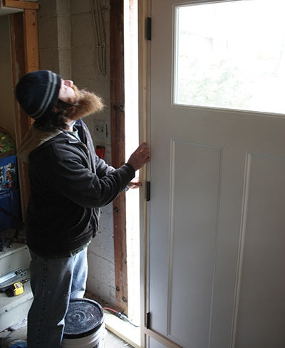 Install studs cut to fit between the sill and top plate, framing the sides of the rough opening.
