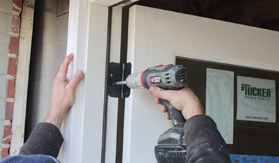 Refer to the manufacturer's instructions for specific steps to install your door. They often come with ong hinge screws that are driven through the hinge locations of the jamb, through shims and into the stud framing. Make sure not to bow the sides of the door frame.