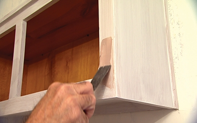 Work the filler into the holes with a putty knife, allow to dry and then sand smooth.