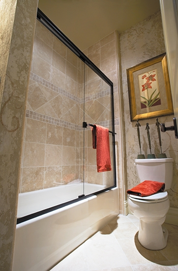 Glass shower enclosures are a popular design trend because they give the bathroom a spacious, luxury spa-like feel.