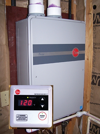 Tankless water heaters only warm the water as it is needed, eliminating the need for the system to continually cycle on to maintain a heated tank. Some units include a remote control with digital display.