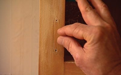 If selecting new hardware, either choose replacements that fit the existing screw holes or else fill the screw holes before painting.