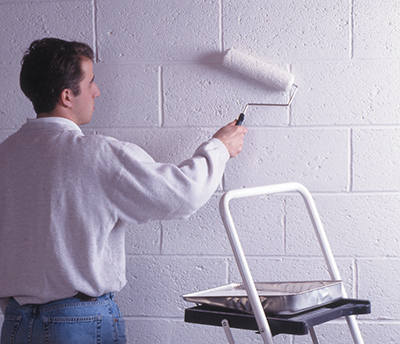 If applying a masonry waterproofer with a roller, back-brush the coating to work it into the pores of the block. A minimum of two coats is required.